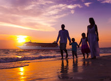 Family Walking Beach Sunset Travel Holiday Concept.  royalty free stock photography