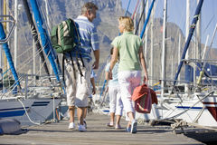 Family walking in boat marina Stock Image