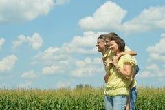 Family walking in corn field Stock Photos