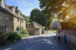 Family walking in Cotswold village, England Royalty Free Stock Image