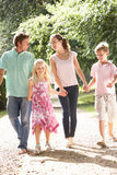 Family Walking In Countryside Together Stock Photography