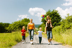 Family walking down that summer path Stock Photography