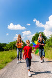 Family walking down that summer path Royalty Free Stock Images