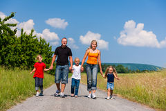 Family walking down that summer path Stock Photos