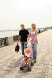 Family walking on embankment Royalty Free Stock Photography
