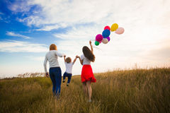 Family walking on the field Royalty Free Stock Photo