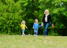 Family walking in forest Stock Photography