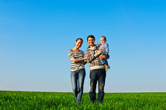 Family walking at the green grass Royalty Free Stock Image