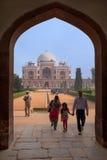 Family walking through Humayun's Tomb gate, Delhi, India Stock Photos