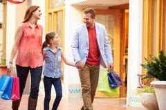 Family Walking Through Mall With Shopping Bags Royalty Free Stock Images