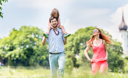 Family walking on meadow having walk Stock Photos