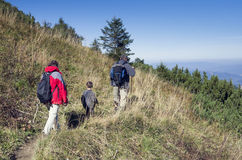 Family walking in mountans Royalty Free Stock Image