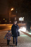 Family walking at night Royalty Free Stock Image