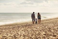 Free Family Walking On The Beach Royalty Free Stock Photo - 69824345