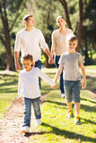 Family walking outdoors. Happy family walking together outdoors Royalty Free Stock Photos