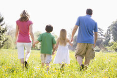 Free Family Walking Outdoors Holding Hands Royalty Free Stock Photo - 5935965