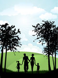 Family walking outside. Silhouette of a family walking outside in the countryside Stock Image