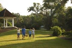 Family walking in park.