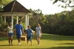 Family walking through park. Royalty Free Stock Image