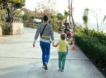 Family walking in park. Mother with son Royalty Free Stock Photography