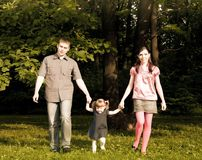 Family Walking In The Park Stock Photo
