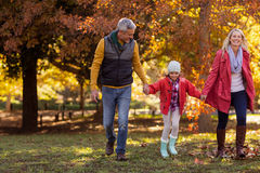Family walking at park during autumn Stock Images