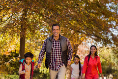 Family walking at park during autumn Royalty Free Stock Photo