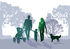Family walking in the park. Illustration of mother, father, child and dog walking in the park seen in silhouette with father pushing the baby in its pram Stock Photo