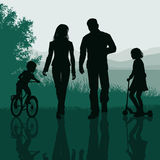 Family walking in a park Stock Photos