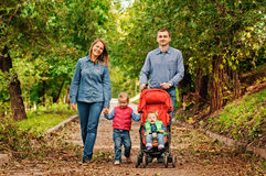 Family walking in park Stock Photo