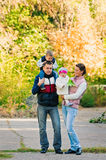 Family walking in park Royalty Free Stock Images