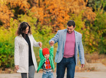 Family walking in park. Young family walking in the park. Autumn Stock Photos