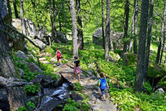 Family walking in a path in mountain Royalty Free Stock Image