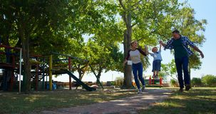 Family walking in the playground 4k stock footage