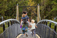 Family Walking at River Suspension Bridge Stock Image