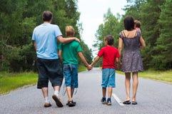 family walking at road Stock Image