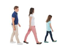 Family walking in a row over white background Stock Images