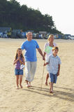 Family Walking On Sand At Beach Stock Photos