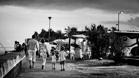Family walking beside the sea