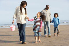 Family Walking By Sea On Winter Beach Royalty Free Stock Photo