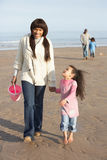 Family Walking By Sea On Winter Beach royalty free stock photos