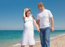 Family is walking on seashore Stock Photo