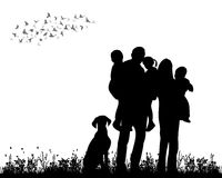 Family walking. Silhouette family walking on grass Royalty Free Stock Image