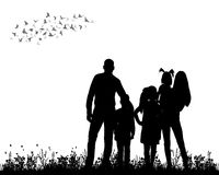 Family walking. Silhouette family walking on grass, playing Royalty Free Stock Images