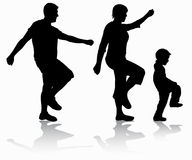 Family walking silhouettes Royalty Free Stock Images