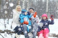 Family walking in  snowy park Royalty Free Stock Photo