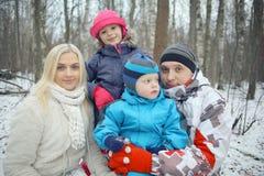 Family walking in  snowy park Stock Photos