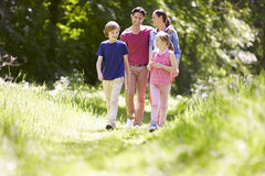 Family Walking Through Summer Countryside Stock Photo