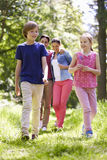Family Walking Through Summer Countryside Royalty Free Stock Image