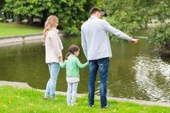 Family walking in summer park Stock Image